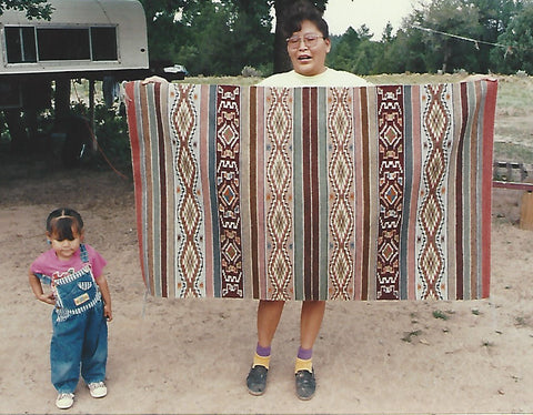 Frances Begay with her daughter and her Wide Ruin Rug