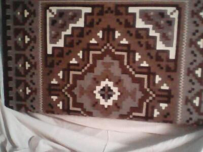 helen bia two grey hill navajo rug on the loom