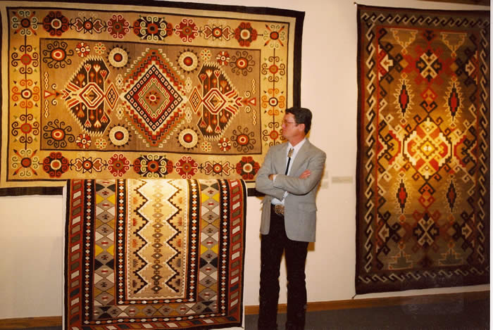 Steve Getzwiller in front of a Teec Nos Pos American Indian rug