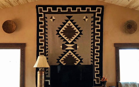 Jackson Hole Navajo Rug and native american baskets