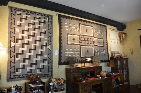 Transitional Native American Rugs on the Wall at Nizhoni Ranch Gallery