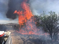 Fire photo courtesy of Arizona Daily Star