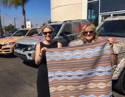Jo Hannah Hoehn and Gail Getzwiller display the Navajo Rug which was used for one of the vehicle wraps