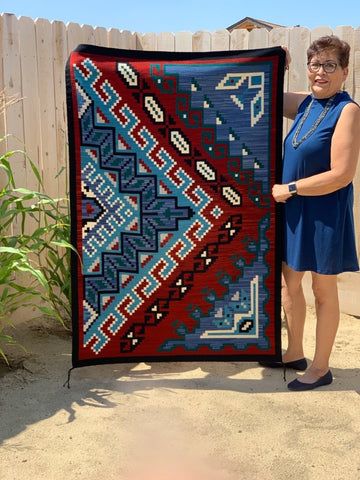Master Weaver Frances Begay with her award winning Blue Gap Navajo rug