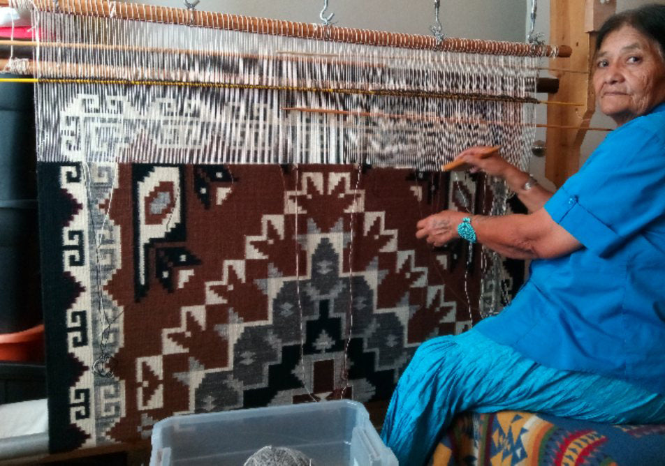 Elsie Bia at the loom of her Two Grey Hills Navajo Rug 11.2018