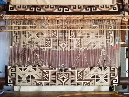 Two Grey Hills Navajo rug on the loom