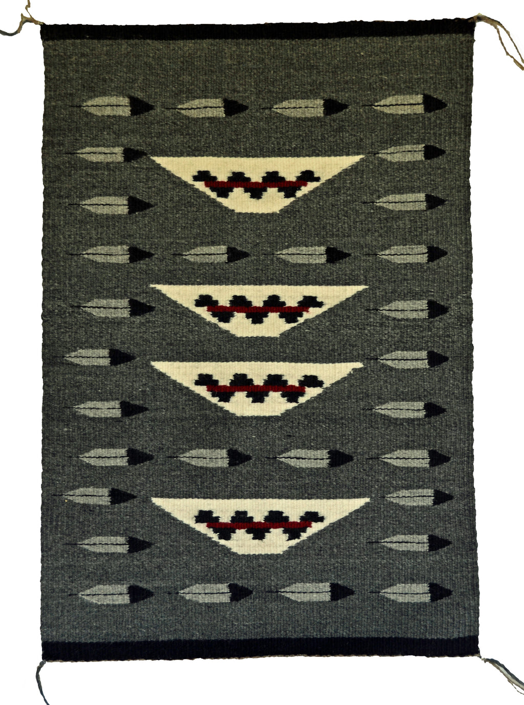 American Indian rug with Navajo wedding baskets and feathers