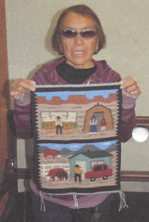 Native American Rug with two different Navajo Farm Scenes with people and hogans held by Navajo weaver Ella Begay