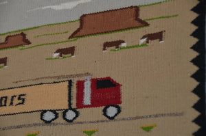 Navajo weaving with Coors truck pictured