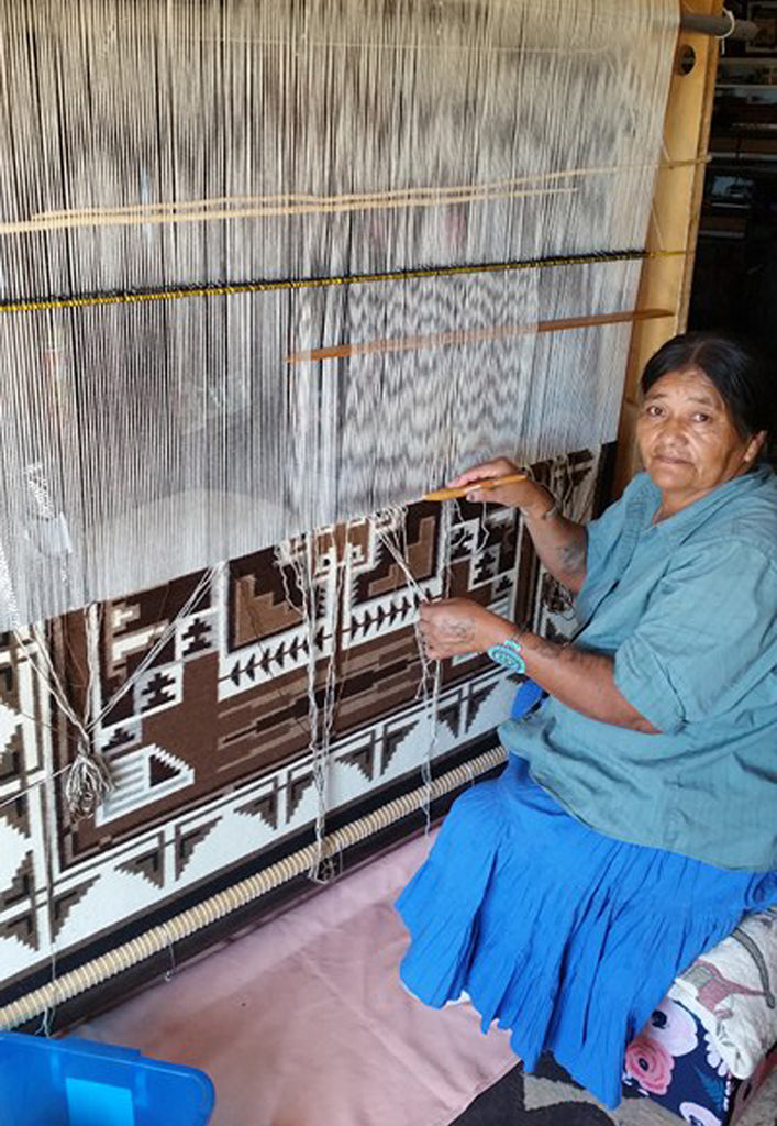 Elsie Bia at the loom of her Two Grey Hills Navajo Rug