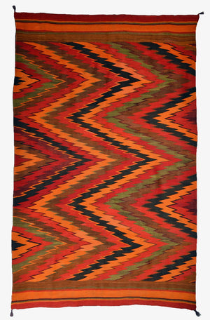 Historical Navajo rug with vibrant jelly bean color
