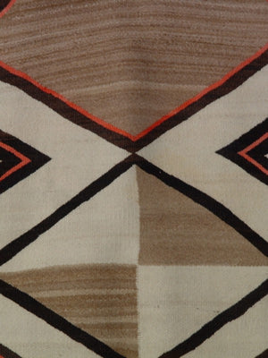 Detail photo of a vintage saddle blanket woven by a unknown Navajo weaver.