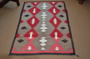 Navajo rug on the floor of the gallery