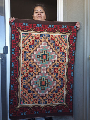 Navajo weaver Ruby Watchman with her Burntwater rug