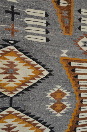 Grey, black and gold Navajo rug with salt and pepper wool