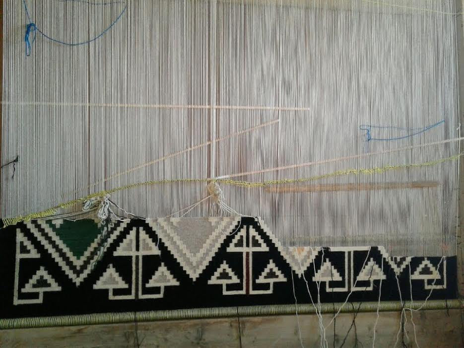 Large Navajo rug on the loom