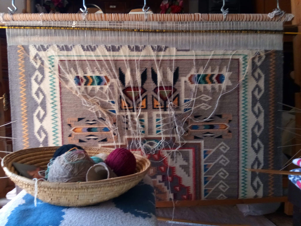 Teec Nos Pos Navajo rug on the loom, almost finished