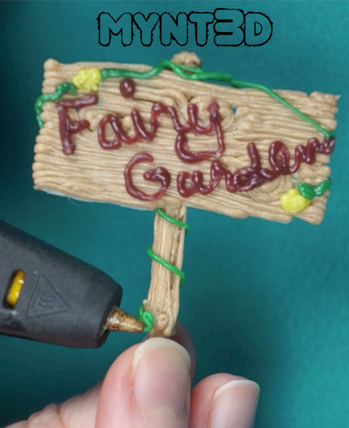 DIY Fairy garden sign made with a 3D printing pen using PLA wood filament | download the free project template from MYNT3D | Get more craft ideas and stencils