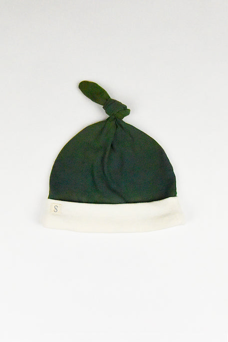 naturally plant-dyed organic cotton kid's clothing, baby santa hat beanie dyed with indigo leaves and weld leaves and flowers