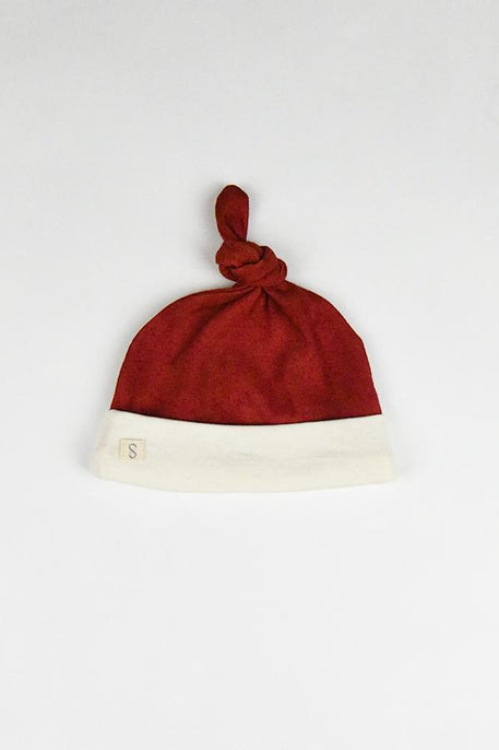 naturally plant-dyed organic cotton kid's clothing, baby santa hat beanie dyed with madder roots