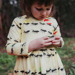 Long-sleeved-yellow-winter-dress-ants-print