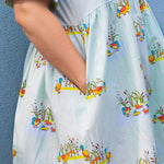 Close up of pocket detail in womens dress in scandi-style print with duck print