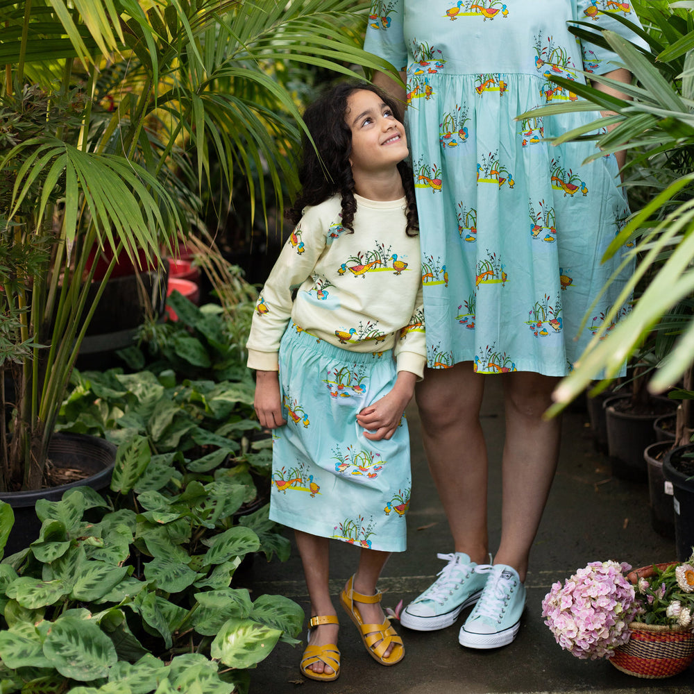 Mum and Daughter wearing matching outfits with duck print in contrasting mint and cream