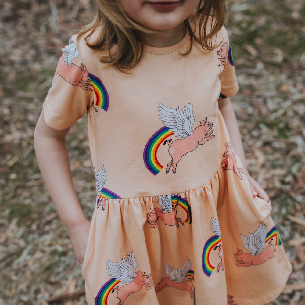 Peach-Pink-girls-pig-rainbow-print-dress-with-pockets