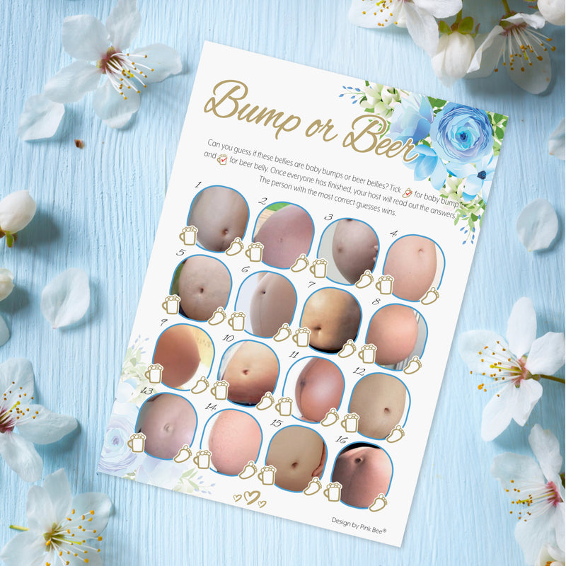 A single baby shower game sheet on a blue table with white flowers