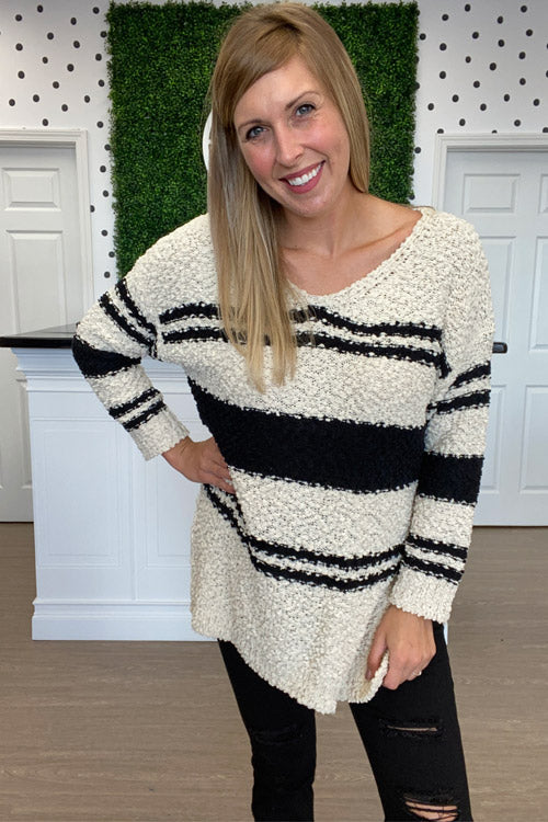 woman in black and white sweater