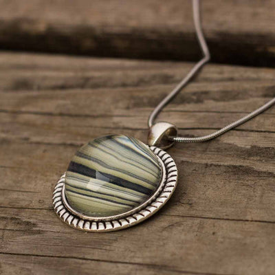 Rings of Saturn Necklace - this planet space science necklace uses an image of Saturn's rings. Great gift for an astronomy or science teacher, scientist, star gazer, or science enthusiast.