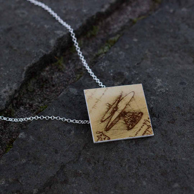 Leonardo da Vinci's flying machine necklace. Great science jewelry gift for a pilot, engineer, or flight enthusiast.