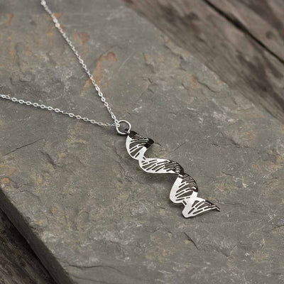 DNA Necklace, complete with major and minor grooves and base pairing. Beautiful science jewelry for a biologist or science student or teacher.
