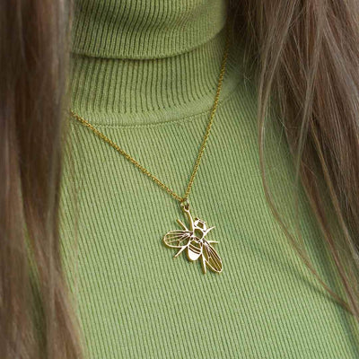 Drosophila fruit fly necklace - science jewelry gift for a student or researcher in biology or genetics. Gold steel version.