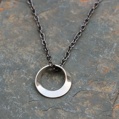 Mobius Necklace on a gunmetal chain - math jewelry, great gift for mathematics students and teachers, artists, and basically anyone