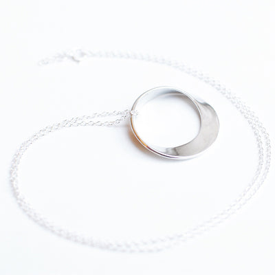 Mobius Necklace on a silver chain - math jewelry, great gift for mathematics students and teachers, artists, and basically anyone