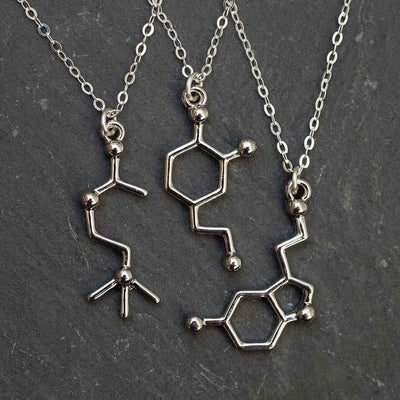 Neurotransmitter molecule necklace - acetylcholine, dopamine, and serotonin. Biology science jewelry that makes a great gift for a scientist, student, or teacher.