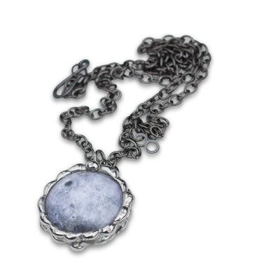 Moon Necklace - space science jewelry for astronomy. Great gift for an astronomer, star gazer, science teacher, or lunar observer. The pendant is hand-soldered. This image shows the far side of the moon.