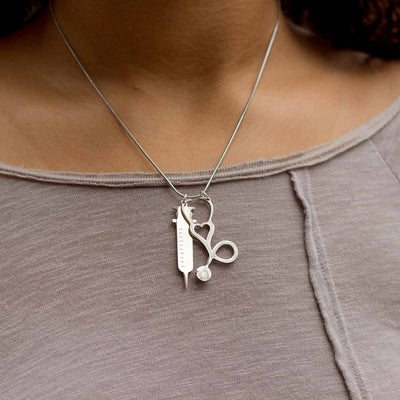 Stethoscope and Syringe Necklace - great jewelry gift for a nurse, pediatrician, doctor, or med student.