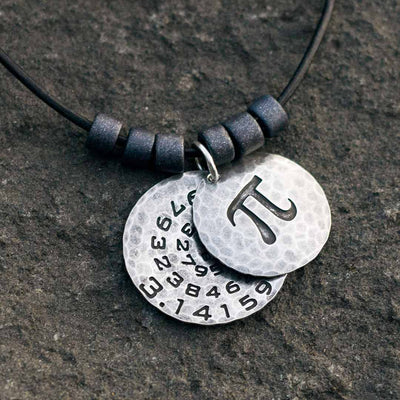 Pi math necklace showing the pi symbol on one disc and pi to 35 decimal places on the second disc. Great gift for a mathematician, a student or a teacher of mathematics.