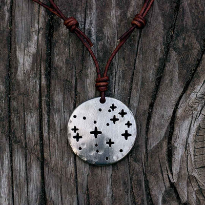 Pleiades constellation necklace - science & astronomy jewelry. Great gift for a star gazer, teacher, or astronomer. Pendant on a brown cord.