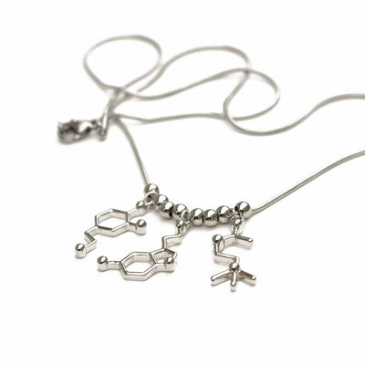 Neurotransmitter molecule necklace that includes dopamine, serotonin, and acetylcholine. Beautiful science jewelry and great gift for a teacher, scientist, or biology student.