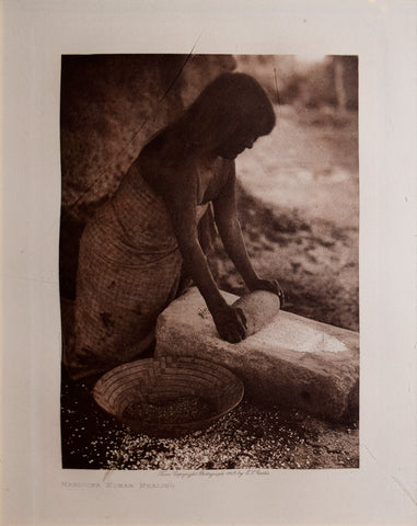 Edward S. Curtis  (1868-1952),  Maricopa Woman Mealing, Page 82
