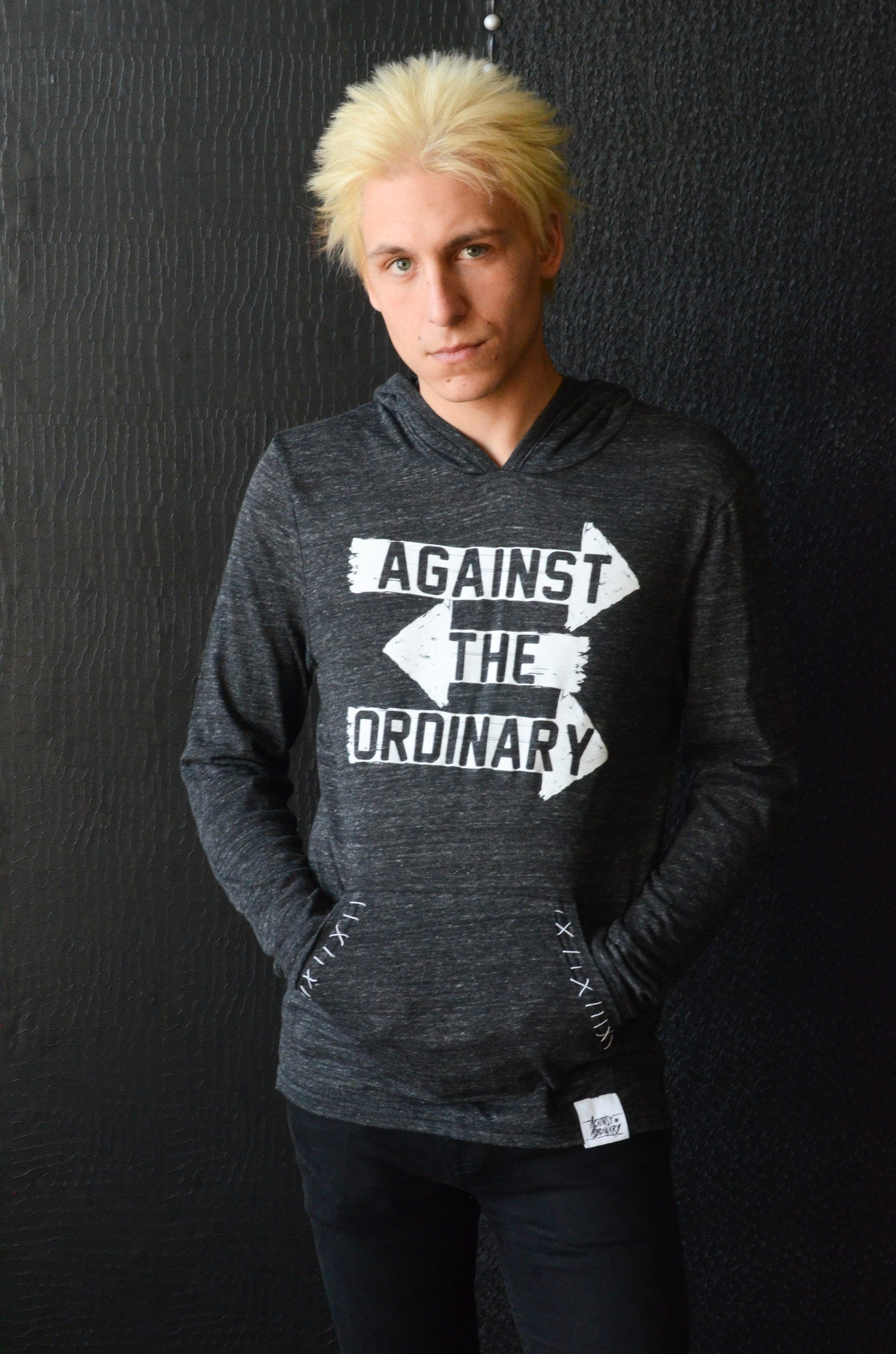 Unisex AGAINST THE ORDINARY Long Sleeved Hooded Tee with ARROW Design