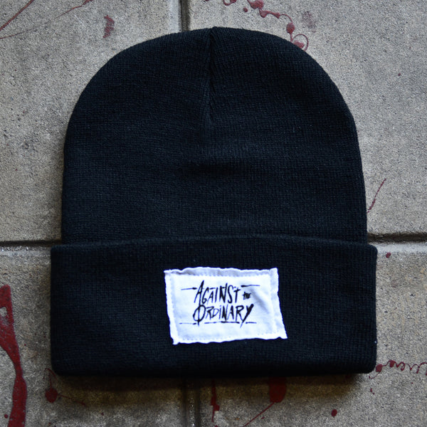 Against the Ordinary Black Beanie with White Stitched Label