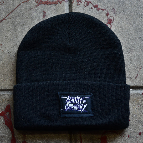Against the Ordinary Black Beanie with Black Stitched Label