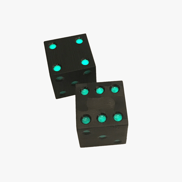Carbon fiber dice glow green