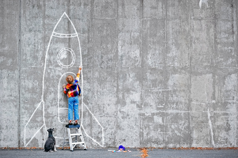 Boy drawing rocket image