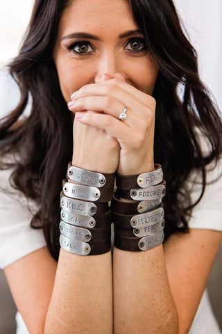 woman wearing stacks of hero bands