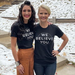 women wearing we believe you shirts